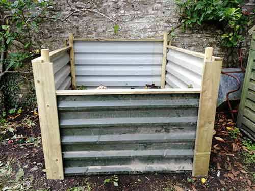 New box roofing sheet compost heap