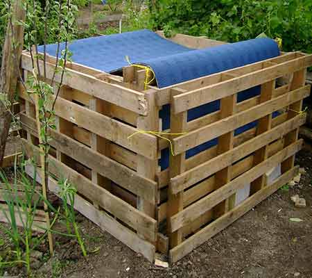 Timber pallet compost heap
