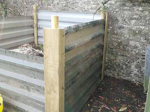 Rear compost heap edges covered