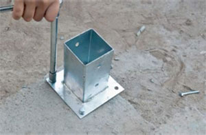 Bolting down fence post holder