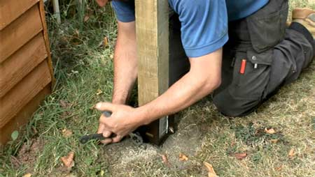 Tighten the bolts to hold fence post in place