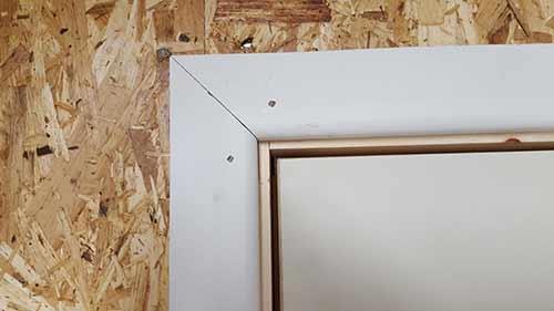 Architrave installed around door frame