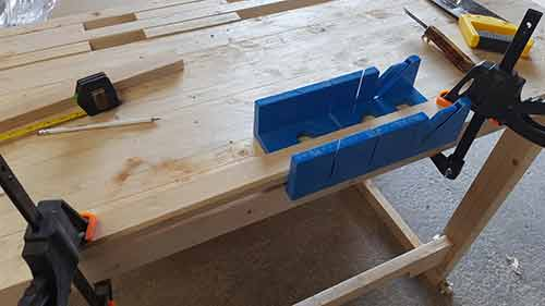 Timber clamped firmly in mitre block