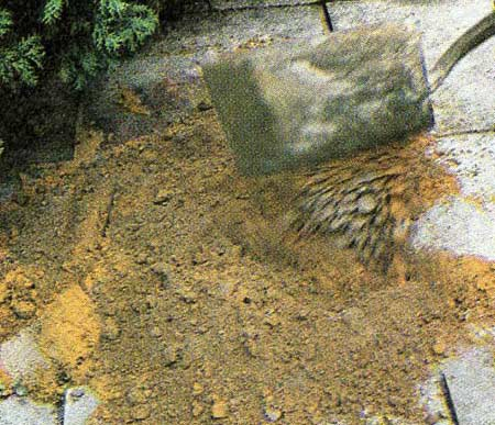 Mixing mortar and sand together