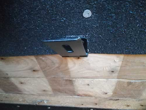 Gate latch screwed to underside of roof