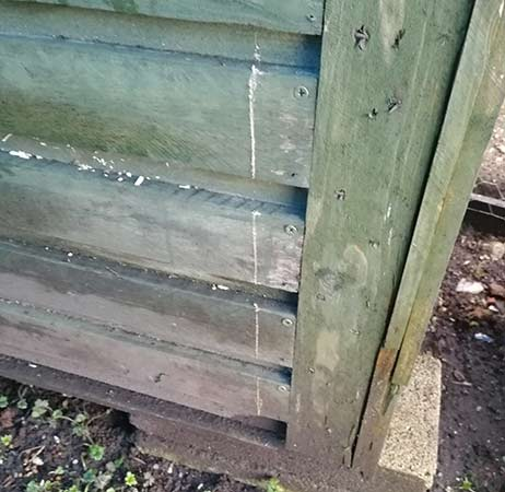 Cutting area marked out on rear of chicken coop