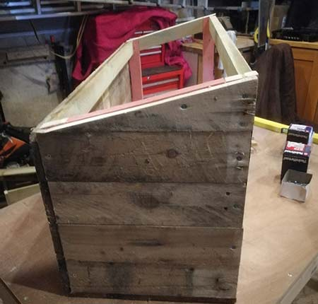 Mitred cladding slat fixed to side of nesting box