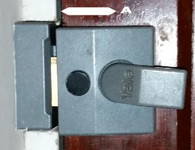 A 40mm night latch backset fitted badly