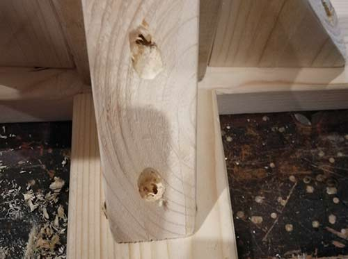 Recess and holes drilled in timber support bracket