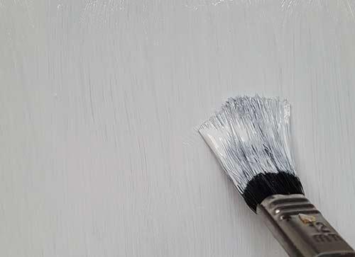 Applying top coat over primer