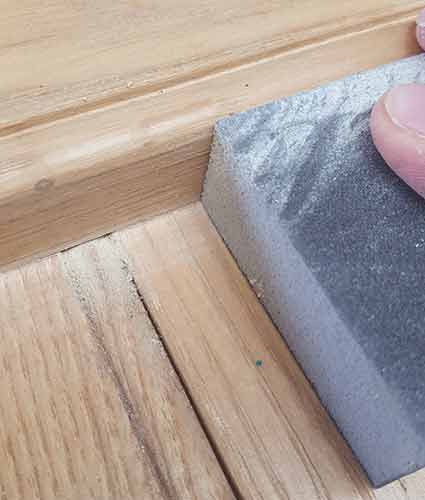 Using a sanding block to sand down ledges