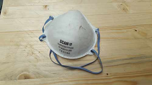 Dust mask used when sanding down