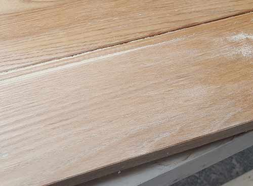 Sanding off varnish on ledge and brace door
