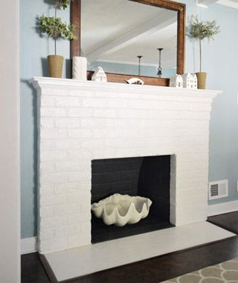 Minimal white painted fireplace