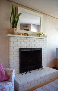 A beautifully painted brick fireplace