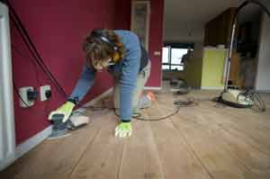 Detail sanding the wooden floor