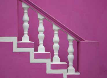 Wooden staircase painted to contemporary style