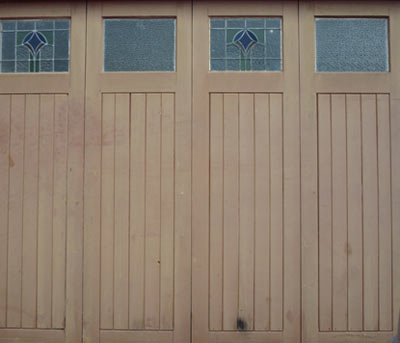 Unpainted wooden garage doors