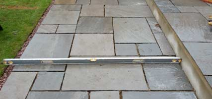 Use a long level to lay your patio