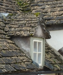 Dormer window in stone tiled roof