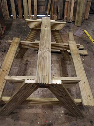 First 2 seating timbers fixed to picnic bench