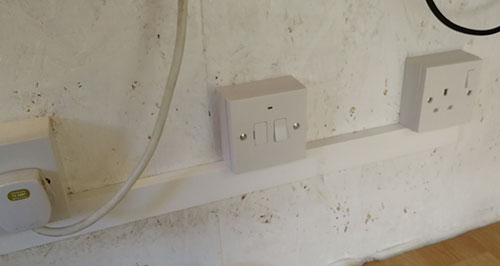 Surface mounted sockets connected using plastic trunking