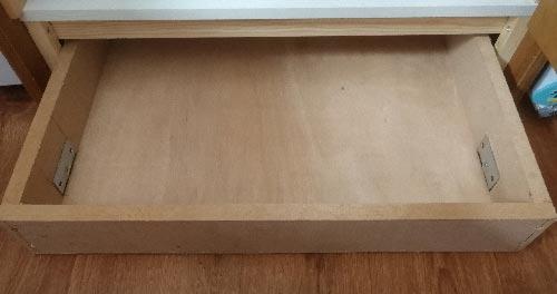 Plinth drawer with castor wheels