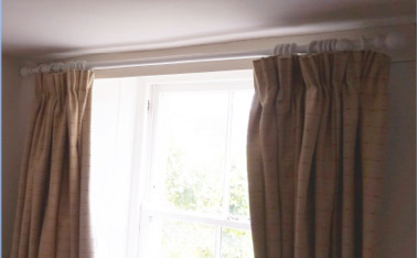 Curtains hung on a curtain pole