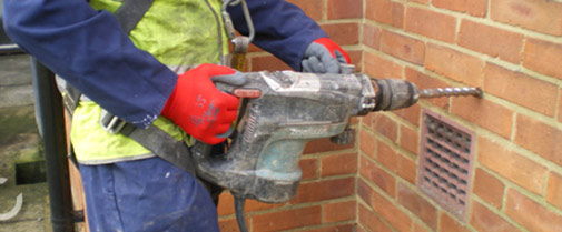 Injected cavity wall insulation and pumped cavity wall insulation drilling into a cavity wall solutioingenieria Images