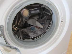 Inside of washing machine drum with manufacturers instructions