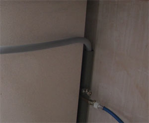 Washing machine cold main and waste outlet pipes connected