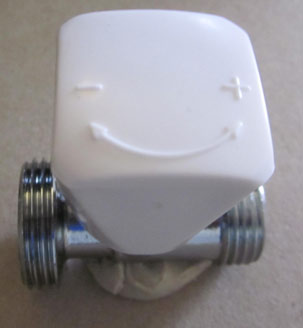 Wheelhead nut opens and closes a radiator valve