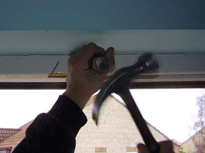 Remove the window head timber by firstly making an angled cut