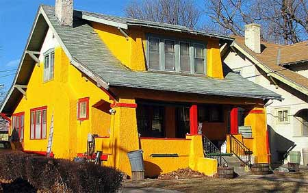 Bright yellow exterior finish on property
