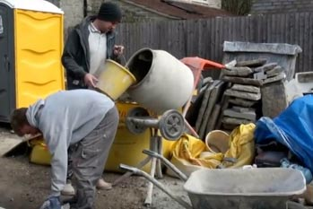 Mixing sand and cement render in a mixer
