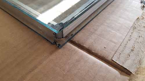 Place spacer on bottom pane and then add top pane