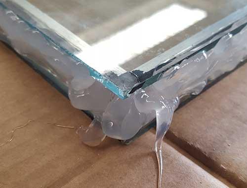 Sealant applied around double glazed unit