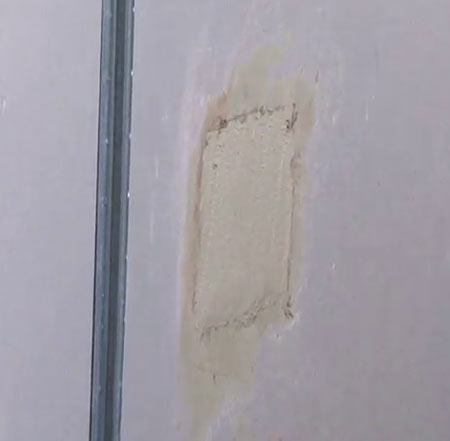 Filled hole in plasterboard