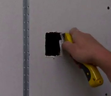 Squaring up plasterboard hole with hobby knife