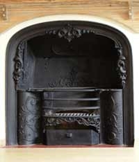 A restored cast iron fireplace