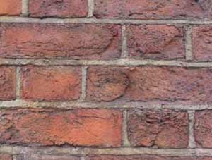 Brick wall with brick faces blown off