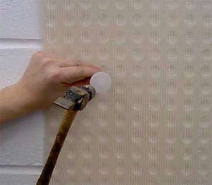 Fit a mesh membrane to your wall to ensure that salts do not reappear in your plaster