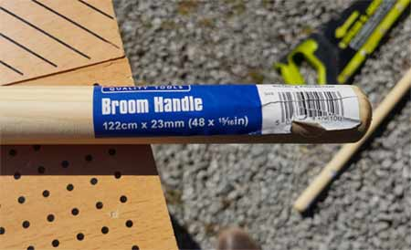 Broom handle to use as rope ladder rungs