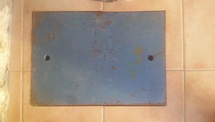 Metal plate covering floor safe