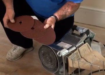 Using an edge sander on timber floorboards