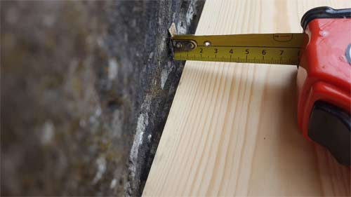 Measure any dips to ensure you remove enough material