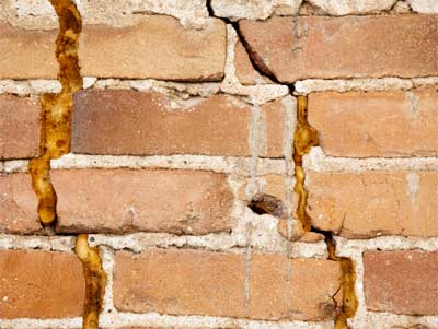 Settlement cracks in outer cavity wall of property