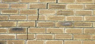 Vertical stepped settlement crack in wall