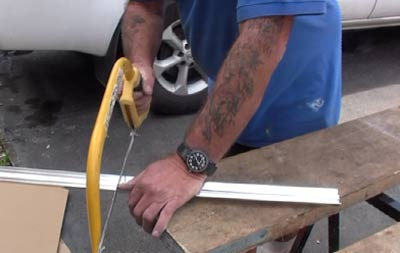 Cutting shower panel beads with a hacksaw