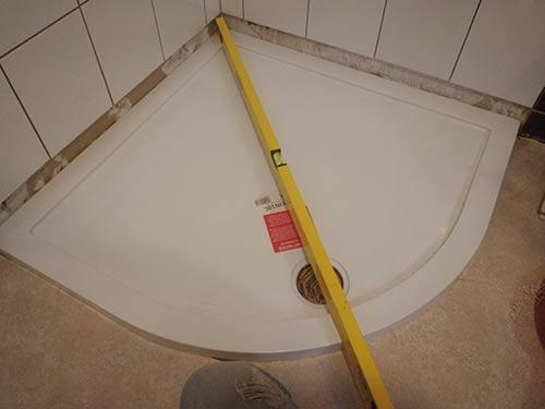 Checking shower tray level